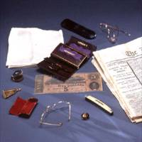 The contents of Abraham Lincoln's pockets from April 14, 1865. Image includes newspaper reporting his assassination.