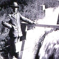 Photo of man at irrigation headgate