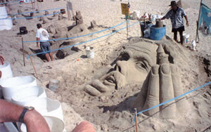 Photo Of A Sand Sculpture King Neptune S Head And Hand